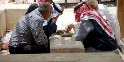A group of men gathered to play mankala in Madaba